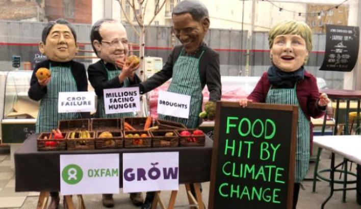 Aksi para aktivis meniruan para pemimpin dunia untuk beraksi mengatasi perubahan iklim jelang pertemuan Paris (dok. oxfam)